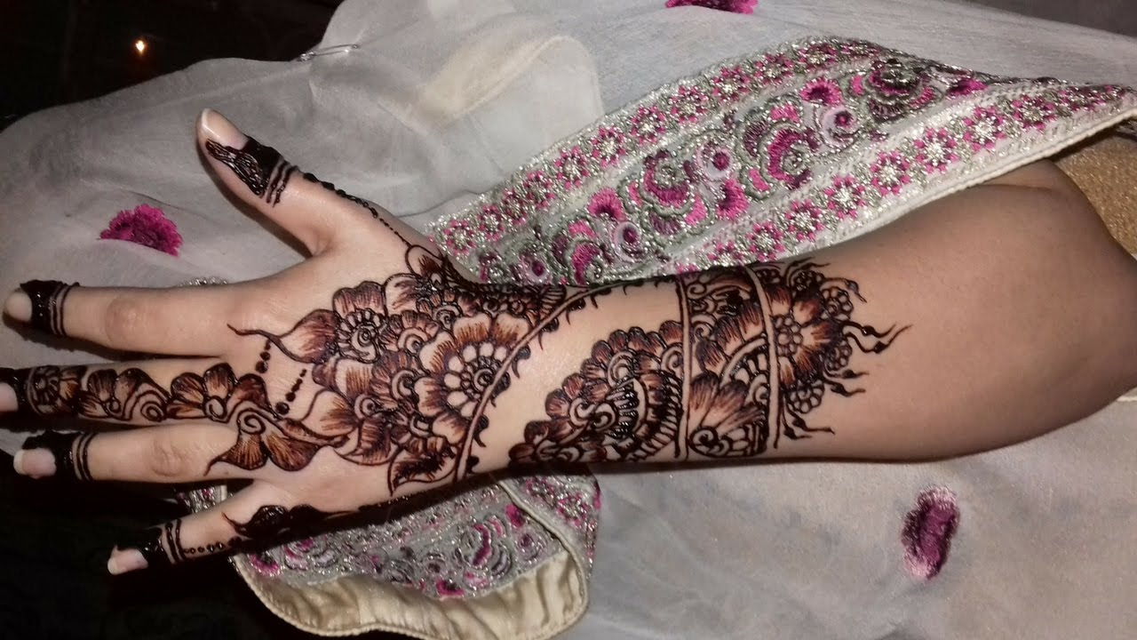 floral style back hand henna designs